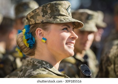 KIEV, UKRAINE - Aug 24, 2015: Girl in a military uniform on march of Independence on the occasion of 24th anniversary of Independence of Ukraine on Khreshchatyk, Kiev