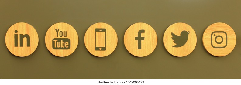 Kiev, Ukraine - August 02, 2018: Set of popular social media wooden icons on the wall of the shop: Facebook, Twitter, Instagram, Linkedin, YouTube and Smartphone.