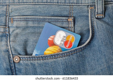 KIEV, UKRAINE - AUGUST 09, 2016: MasterCard credit card in front pocket of blue jeans closeup. Mastercard Worldwide is an American multinational financial services corporation.