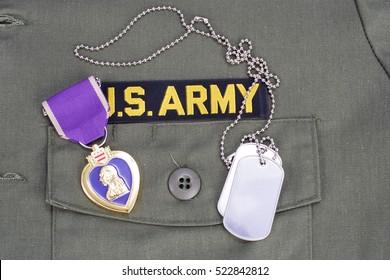 KIEV, UKRAINE - August 1, 2016. Purple Heart award on US ARMY olive green uniform
