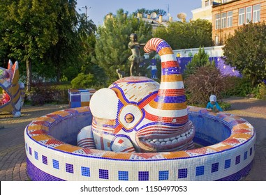 Kiev, Ukraine - August 1, 2018: Picturesque fountain with girl and elephant on the Landscape  Alley (Pejzazhna alleyway) made by Konstantin Skretutskiy based on Alice in Wonderland in Kiev