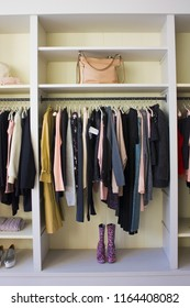 Kiev, Ukraine - August 1, 2018: Clothes hang on a shelf in a designer clothes store