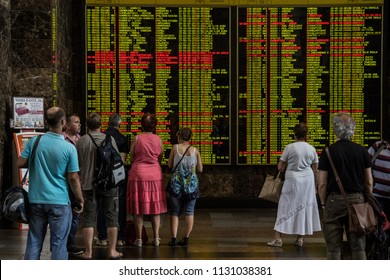 KIEV - UKRAINE - AUGUST 10, 2015: Passengers looking at the electronic departures and arrivals board in the main train station of Kiev, getting ready to travel