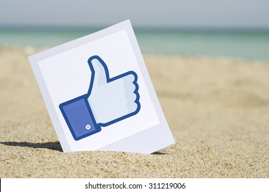 KIEV, UKRAINE - AUGUST 10, 2015: Facebook like logo for e-business, web sites, mobile applications, banners, printed on paper and placed in the sand against the sea Social network facebook sign.