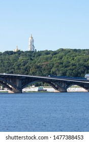 KIEV. UKRAINE. AUGUST 10, 2019: View of the right bank of Kiev, the Lavra and the Rodina-Mother museum complex, from the Dnieper River. Kiev bridges