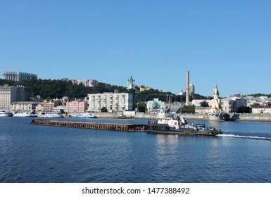 KIEV. UKRAINE. AUGUST 10, 2019: View from the Dnieper River to the Kiev region Podil and River Port. River boats on the water. Dnieper River. Kiev bridges