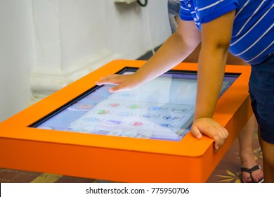 Kiev, Ukraine August 12, 2017: - The child plays the game on a large touch screen close-up