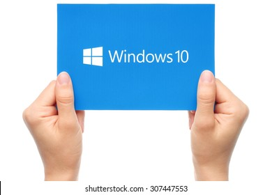 KIEV, UKRAINE - AUGUST 18, 2015:Hands hold Windows 10 logotype printed on paper. Windows 10 is an operating system developed by Microsoft.