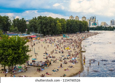 "KIEV, UKRAINE - August 2018: Crowded public beach ""Venice""  in Kiev by Dnipro river, Ukraine"