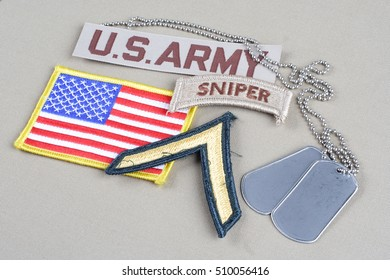 KIEV, UKRAINE - August 21, 2015. US ARMY Private rank patch, sniper tab, flag patch and dog tag