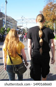 Kiev, Ukraine August 24, 2011: A guy with very long hair at the celebration of 20 years of independence of Ukraine