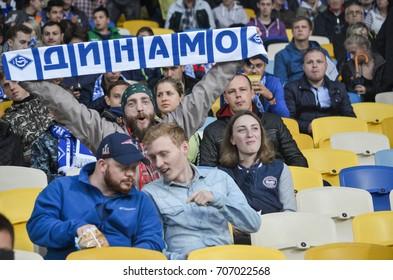 KIEV, UKRAINE - August 24, 2017: A charismatic fan at the football stadium supportsthe team during the UEFA Europa League match between Dynamo Kyiv vs CS Maritimo (Portugal), Ukraine