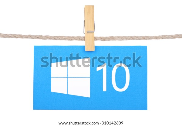 KIEV, UKRAINE - AUGUST 25, 2015: Windows 10  the operating system developed by Microsoft. Windows 10 logo hanging on the clothesline isolated on white background.