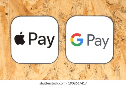 Kiev, Ukraine - August 25, 2020: Apple Pay and Google Pay icons printed on paper, on wooden background. Apple Pay is a mobile payment, digital wallet service. Google Pay is a digital wallet platform