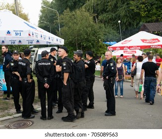 Kiev, Ukraine - August, 26,2017: a group of policemen in uniform awaiting the end of the event in the park