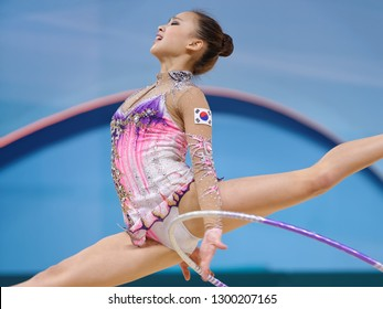 KIEV, UKRAINE - AUGUST 28, 2013: Yeon Jae Son, Korea performs with hoop during 32nd Rhythmic Gymnastics World Championships. The event is held in Palace of Sport