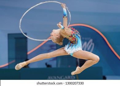 KIEV, UKRAINE - AUGUST 28, 2013: Yana Kudryavtseva, Russia performs with hoop during 32nd Rhythmic Gymnastics World Championships. Eventually she won silver medal
