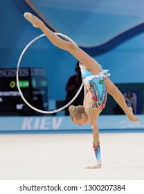 KIEV, UKRAINE - AUGUST 28, 2013: Yana Kudryavtseva, Russia performs with hoop during 32nd Rhythmic Gymnastics World Championships. Eventually she won silver medal