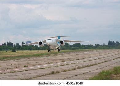 Kiev, Ukraine - August 3, 2011: Antonov An-148 regional passenger jet plane is taking off from the manufacturer's runway