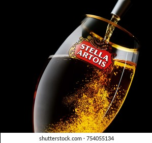 Kiev, Ukraine - August 3, 2017:Cold glass of Stella Artois beer on a black background.?eer poured into a glass on a black background
