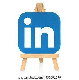 Kiev, Ukraine - August 30, 2016: LinkedIn logo printed on paper and placed on wooden easel. LinkedIn is a well-known social networking service
