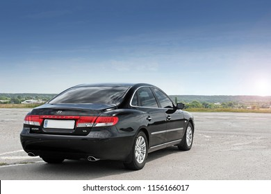 Kiev, Ukraine - August 6, 2018: Hyundai Grandeur on the road. A car in the background of a clear sky. View of the car from the rear