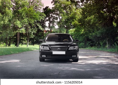 Kiev, Ukraine - August 6, 2018: Hyundai Grandeur in the forest on the road. View of the car in front