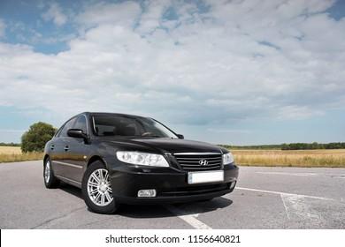 Kiev, Ukraine - August 6, 2018: Hyundai Grandeur on the road. Black car on a background of beautiful sky