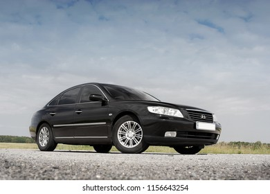 Kiev, Ukraine - August 6, 2018: Hyundai Grandeur. Black car on a background of beautiful sky. View of the car from the bottom