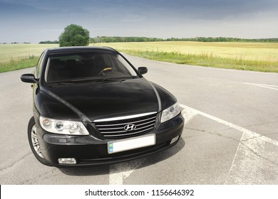 Kiev, Ukraine - August 6, 2018: Hyundai Grandeur in the background of the field. The car is a front view