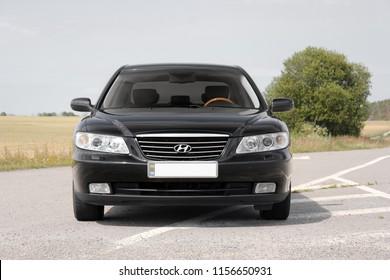 Kiev, Ukraine - August 6, 2018: Hyundai Grandeur on the road. View of a black car in front