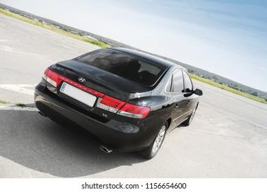 Kiev, Ukraine - August 6, 2018: Hyundai Grandeur on the road. View of the black car from behind