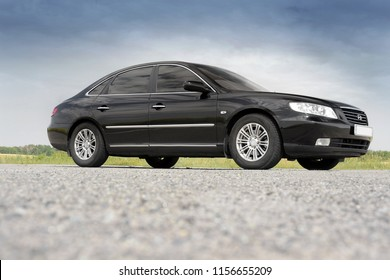 Kiev, Ukraine - August 6, 2018: Hyundai Grandeur in the background of a beautiful sky. View of the car from the bottom