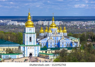 Kiev, Ukraine. Cupolas of St. Michael's Golden-Domed Monastery and river Dniepr panoramic city view