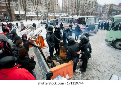 KIEV, UKRAINE - DEC 10: Paramilitary group of policemen in uniform standing at the barricades, protesters protected, during anti-government protest Euromaidan on December 10, 2013 in Kyiv, Ukraine.