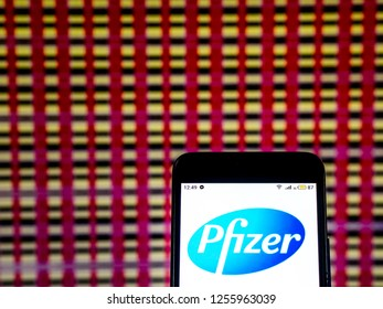 KIEV, UKRAINE - Dec 11, 2018: Pfizer Pharmaceutical company  logo seen displayed on smart phone.