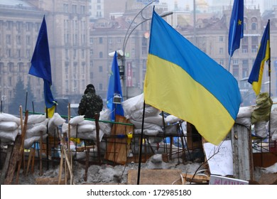 KIEV, UKRAINE - DEC 20: Barricades with ukrainian and european flags at the mainsquare of Kiev during anti-government pro-european protest on December 20, 2013, Ukraine.