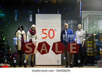 Kiev, Ukraine - Dec 28, 2016: mannequins standing in the shop window Display casual clothing store in the Mall. Clearance sale, discounts up to 50%  Kiev, Ukraine - Dec 28, 2016: