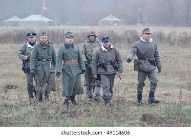 KIEV, UKRAINE - DEC 6: Members of a history club Red Star wear historical German uniforms during a WWII reenactment 'Defense Kiev' in 1943 December 6, 2009 in Kiev, Ukraine