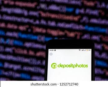 KIEV, UKRAINE - Dec 7, 2018: Depositphotos Company logo seen displayed on smart phone.