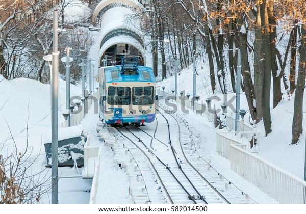 KIEV, UKRAINE - DECEMBER 03, 2016: Winter Kiev funicular wagon pulls into the bottom station