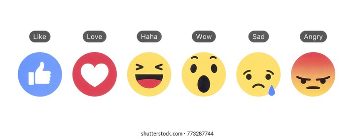 Kiev, Ukraine - December 06, 2017: Facebook like button and Empathetic Emoji Reactions printed on white paper. Facebook is a well-known social networking service.