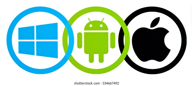 Kiev, Ukraine - December 07, 2016 Collection of popular operating system logos printed on paper: Apple, Windows and Android.