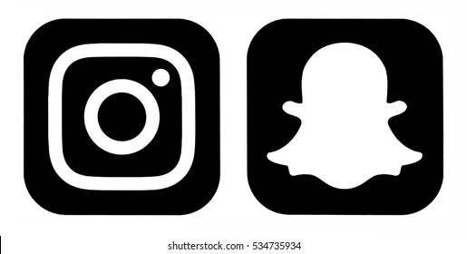 Kiev, Ukraine - December 07, 2016: Instagram new icon and Snapchat logo icon printed on white paper. Popular social media icons Instagram and snapchat is a popular social networking for sharing photo.