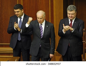 KIEV, UKRAINE - December 08, 2015: US Vice President Joe Biden (C),Ukrainian President Petro Poroshenko (R),Speaker of Parliament Volodymyr Groysman (L) after speech Biden at the Ukrainian Parliament.