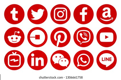 Kiev, Ukraine - December 11, 2018: Popular circle red social media icons printed on white paper: Facebook, Twitter, Instagram, Pinterest, LinkedIn, Tumblr and others