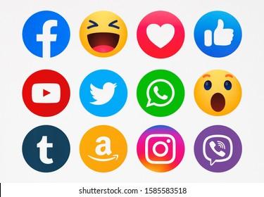 Kiev, Ukraine - December 11, 2019: New Facebook, like button  Empathetic Emoji reactions, Twitter, YouTube, Instagram, WhatsApp,Viber, Amazon, Tumblr  printed on paper.