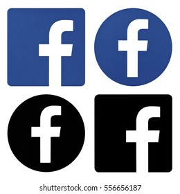 Kiev, Ukraine -  December 17, 2016:Collection of facebook logos printed on white paper.Facebook is a popular social networking service.