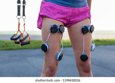 Kiev Ukraine December 17, 2017: Compex electrostimulator for fitness. Install electrostimulator on the muscles of the legs.