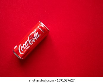 Kiev, Ukraine - December 17, 2019:  Flat lay of can of Coca Cola on a red background